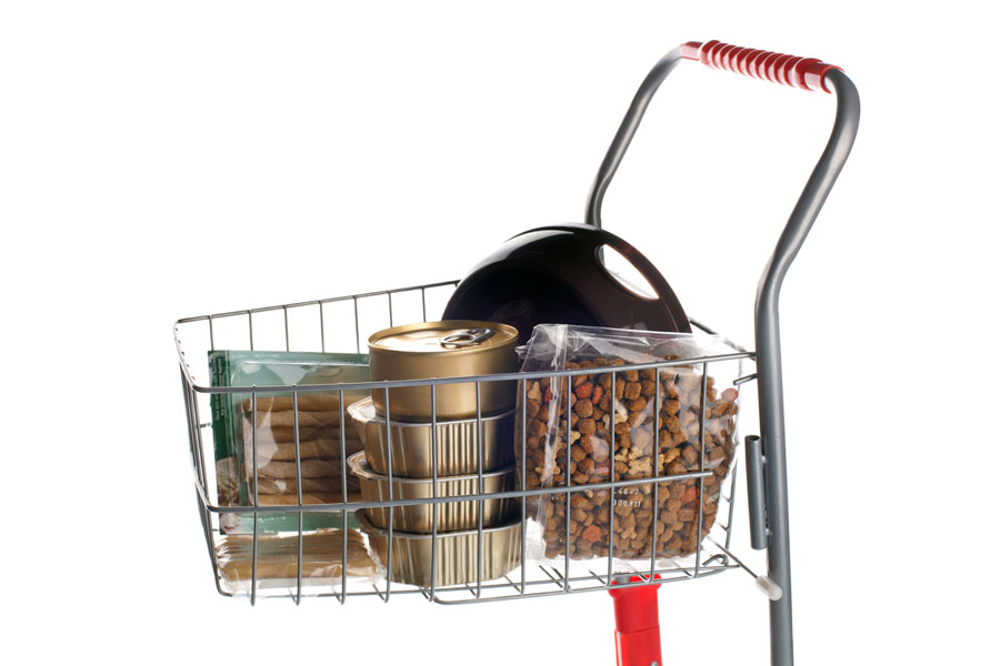 Shopping cart full of dog food on white background